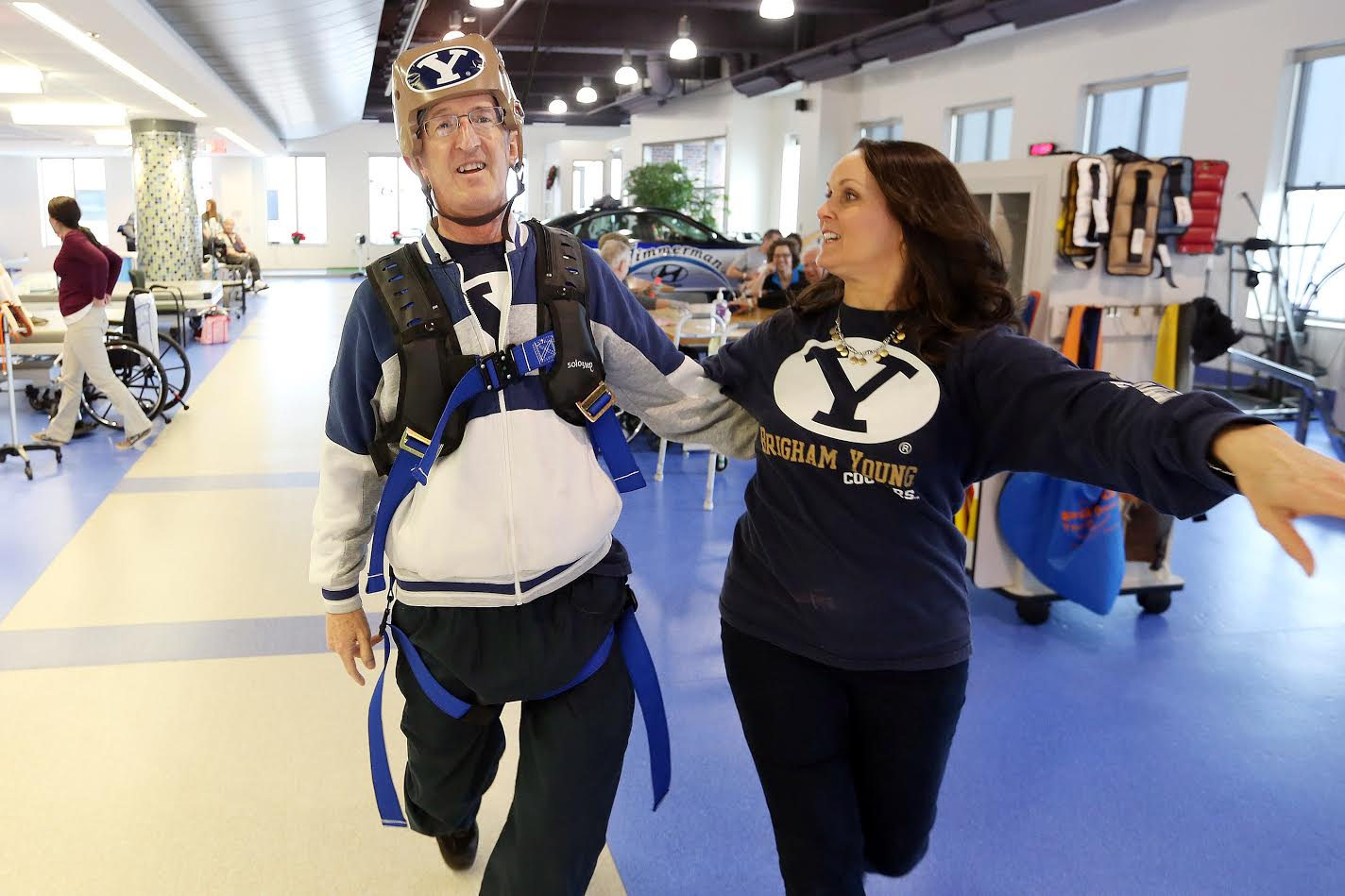 Doug and Jill Beardsley dance together using a harness and track system during physical therapy in UnityPoint Health-St. LukeÕs HospitalÕs Physical Medicine and Rehabilitation gym in Cedar Rapids on Thursday, Dec. 15, 2016. Doug has been in rehabilitation following a brain infection that required surgery, and the harness system has enabled him to dance with his wife as part of his physical therapy. (Liz Martin/The Gazette)