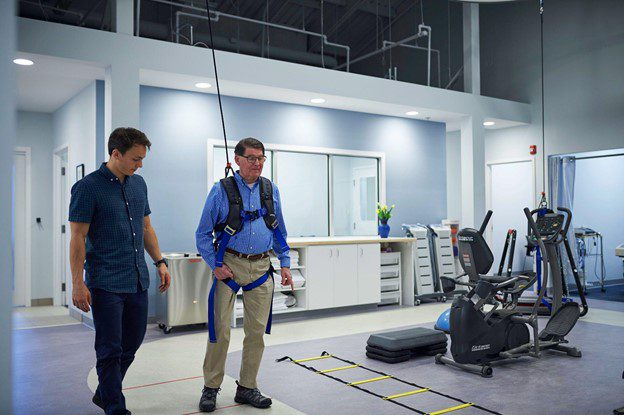 Man using solo step for rehab